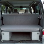 Rear storage behind and beneath the rear bench when in the upright configuration.