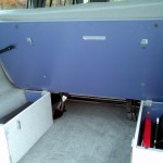 Platform behind rear bench lifts (with support straps) for easier access beneath when loading or unloading.