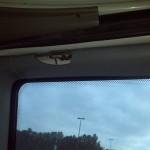 Trim cracked at top of sliding door, left.