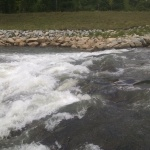 """Site of the """"Hooch Wave"""" from standing on a rock on river left. Seems more like a rock jumble than a wave today.  Compare this to the photo linked above from the AW webpage, which is what I recall it looking like in 2010."""
